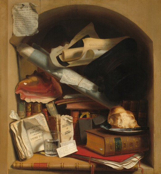 "A crusty piece of bread, a short glass of water, a black top hat, a rosy-pink conch shell, and more than a dozen books and rolls and slips of papers are crammed into an arched alcove in this nearly square still life painting. Lining the bottom edge of the alcove, the long, thin spine of a caramel-brown book is printed with the title, ""CHOICE CRITICISM ON THE EXHIBITIONS AT PHILADELPHIA"" in gold against a crimson red background between two ridges. To our right, a scarlet-red portfolio holds a sheaf of loose papers under a thick book titled ""LIVES OF THE PAINTERS."" A crusty hunk of bread and a black-handled knife sit on a ceramic plate on the thick book. To our left, two calling cards with handwritten notes lean on the short glass of water. Both are addressed to ""Palette"" and one is an invitation to visit after tea and other asks about a debt of five dollars. The glass holds open the pages of a book propped against the niche, and the title page reads, ""ADVANTAGES OF POVERTY THIRD PART."" The title of a second book behind the glass, missing its cover, reads, ""PLEASURES OF HOPE,"" though the page is ripped through the word ""hope."" The light green, coffee brown, or cardinal-red spines of a row of books behind this, along the back of the niche, are titled, from left to right: ""CHEYENE ON VEGETABLE DIET,"" then ""MISERIES OF LIFE"" to our left and ""BURTONS ANATOMY OF MELANCOL"" and ""SIGNS OF THE TIMES"" near the center. One of the two spines in shadow to our right reads ""CALAMITIES OF AUTHOR."" A protractor tucked into a small notebook with an elephant-gray cover and ruby-red page edges leans on the books near the center. More books are piled on top. Three of those spines are written in cursive handwriting with ""Unpaid Bills,"" ""We Fly by Night,"" and ""No Son No Supper."" The conch shell sits along the edges of the standing books below to our left, with its gleaming pale pink and golden tan interior facing us. A tightly rolled sheaf of papers wrapped with a sky-blue sheet rests diagonally from the upper left corner of the niche down behind the bread. What looks like a newspaper clipping is tied at the center with the headline ""Just Published."" A tattered black top hat is wedged between the tightly rolled paper and loose, curling papers stacked above. One of the loose sheets is titled ""LAUGHING PHILOSOPHER"" and handwriting on another reads, ""Perspective view of the County Gaot of Philadelphia."" Another newspaper clipping is affixed to the upper left face of the beige-colored, possibly stone niche. It has the headline, ""SHERIFF'S SALE THE PROPERTY OF THE ARTIST,"" and continues, ""Consisting of One Cradle, One Blanket, Two pair of Ruffles, Petticoat, Silk Stockings, and Peck of Potatoes. Four Pictures, of Roast Pigs, Turkies Decanters of Wine and Plumb Cake Painted from Recollection. Fall of the Giants, and View of Paradise, sixteen feet by twenty. Comforts of Matrimony, odd volume. Short Cut to Wealth. Sermon on The Vanity of Human Pursuits. Philadelphia Jan 1st 1812."""