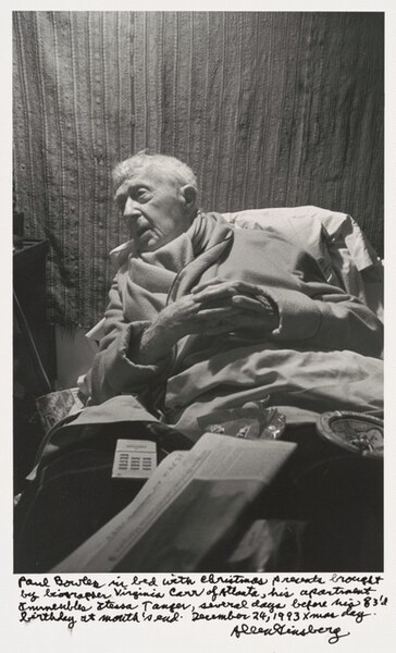 Paul Bowles in bed with Christmas presents brought by biographer Virginia Carr of Atlanta, his apartment Immeuble Itesa Tangier, several days before his 83