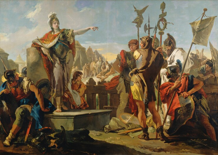 A woman wearing a breastplate and helmet over a toga stands to our left on a platform, gesturing with one arm extended to a group of about a dozen soldiers gathered around her in this horizontal painting. The woman has pale white skin and most of the soldiers have ruddy complexions. The woman stands with her body facing us but she turns her head to our right, seeming to look towards but not at the knot of soldiers clustered there. She leans on her right elbow, on our left, resting on the flat top of a broken column and holds a scepter in that hand. Her opposite arm is raised and her fingers are extended except for the index finger and thumb, which touch to make a circle. Her gold helmet is encrusted with gems and a white plume issues from the top. Her red and gold cloak is fastened around her neck and falls open to reveal her armor and sandal-clad feet. A shield rests on the platform near her feet and other pieces of armor are scattered on the dirt, desert-like ground near the platform below. A young boy with chestnut curls holds her cloak behind her and to our right. In the lower left corner of the painting, one soldier seems to sit on the edge of the platform and he twists and looks up at the woman. Several soldiers standing in a group to our right carry shields, banners, and tall weapons like halberds. They wear helmets and breastplates, and cloaks in canary yellow, crimson, and ivory. The man closest to us stands with his back to us and he looks over his shoulder towards the woman. An animal skin wraps around his shoulders and the head of the animal drapes over his head. More soldiers and tents in the middle distance are painted in almost monochromatic tones of peanut brown and taupe. The sky above is blue with a few white clouds, except for a band of soft yellow along the horizon.