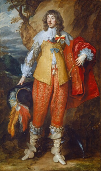 A man with cream-colored skin, wearing an elaborate, gold-embroidered jacket and pants in amber yellow and tomato red stands in front of a landscape with a rocky protrusion and steel gray clouds in this vertical, full-length portrait painting. He stands with his body facing us but turns his head slightly to our left and looks off in that direction with slate-blue eyes under curving brows. His smooth cheeks are lightly flushed in his oval face. His full pink lips are closed and are framed by a mustache and small goatee under his lower lip. His wavy brown hair falls in bangs across his forehead and down to his shoulders. One longer lock has been braided and tied with a yellow and red bow. A wide, lace collar extends from his neck to drape over his shoulders, overlapping a piece of metal armor around the neck, called a gorget. His butter yellow jacket, a doublet, is embroidered with gold along the hems and where it hangs open down the front to show a white shirt beneath. Gold embroidered silver sleeves are cut with long slits to also show the white linen beneath, and end with layers of lace at the wrists. A crimson red coat or cape hangs over his left arm, on our right. His tomato-red pants are covered all over with gold stitching above ivory-white, calf-high boots. He holds a wide-brimmed, black hat adorned with soft red, white, and marigold orange feathers in his right hand, on our left. An armored breastplate rests at his feet. He stands on a dirt ground with a tall boulder immediately behind him to our right. The landscape in the distance to our left has a sky filled with steel-gray clouds above trees and hills.