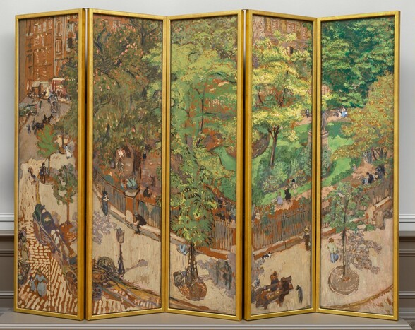 """A screen made up of five tall, rectangular panels, set side by side and each surrounded by a gold frame, is painted as a single scene showing a tree-lined sidewalk curving around a park in a city. The scene is loosely painted with short, rounded brushstrokes. The top two-thirds to three-quarters of most of the panels are filled with the lime and olive-green leaves of the trees that line the sidewalk and park. In the leftmost panel, the sidewalk and road lead back to a row of caramel-brown building façades. The sidewalk is pale taupe, and the street is painted with dashes of the same taupe against terracotta brown, suggesting cobblestones. Spindly trees are spaced in a row along the sidewalk in round holes covered with smoke-gray metal grates. A black fence, painted with thin, sometimes broken black lines encloses the park beyond, which has a dirt-colored path around plantings and the vivid spring-green lawn. Touches of pink on the sage-green tree to our left in the park suggest flowers. A gray statue on a high plinth is partially lost in the break between the two rightmost panels. Men, women, and children, painted with a few strokes of black, gray, or marine or periwinkle blue walk along the sidewalk and the garden path, or sit at the base of the fence or on benches spaced along the sidewalk. The women seem to wear long dresses and the men dark clothing and hats. Two carriages seem to be pulled up on the street near a lamp post alongside the sidewalk near the lower left. In the leftmost panel, horse-drawn carriages move along the road leading back to the buildings, and more people seem to be gathered on the opposite sidewalk, near the left edge of the panel in the distance. The artist signed the work with brown paint in the lower right corner: """"E. Vuillard"""". The panels of the screen have been set up so the panels rest on a platform or on the floor in a shallow zig-zag pattern, in a room with an off white wall and bisque brown molding along the floor."""