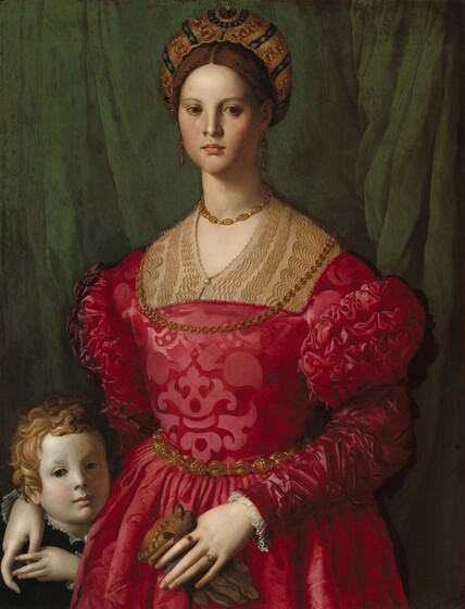 A woman wearing a crimson brocade dress and gold jewelry fills most of this vertical portrait, but her right hand, on our left, rests on the shoulder of a young boy tucked into the lower left corner of the panel. The woman and boy both have pale white skin, and both face and look out at us against an emerald green curtain that falls behind them. The woman has brown eyes, a straight nose, full pink lips, smooth skin, and a long neck. Her brown hair is pulled back under a turban heavily embroidered with gold. The woman's dress has puffed shoulders and decorative slashes on the sleeves. One gold chain rests on her throat and the other falls over her chest. She wears long gold earrings, a gold belt, and two gold rings. She holds a brown leather glove in her left hand. The boy's face is even with the woman's waist, and he raises his left hand to hold hers, draped over his shoulder. He has curly blond hair and dark eyes, and he wears black with a ruffled white shirt just visible at his collar.