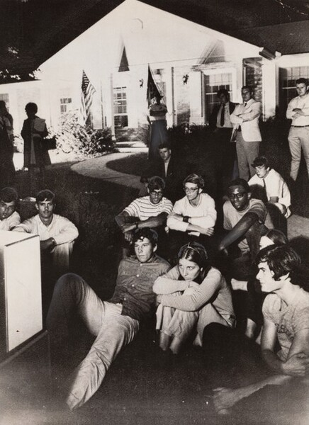 Spectators Sit on the Lawn at the Stephen Armstrong Home...