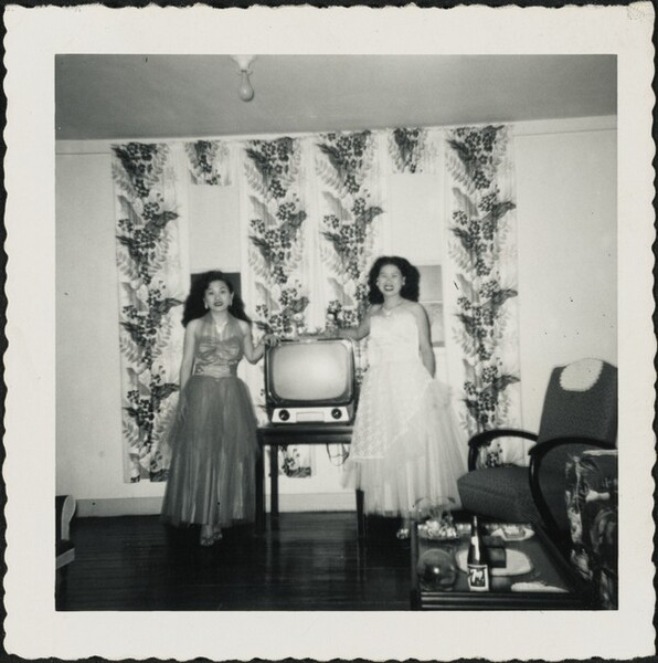 Untitled (Two women in gowns in front of television)