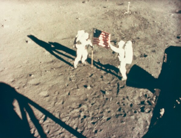 Neil Armstrong and Buzz Aldrin Deploy Flag on the Moon