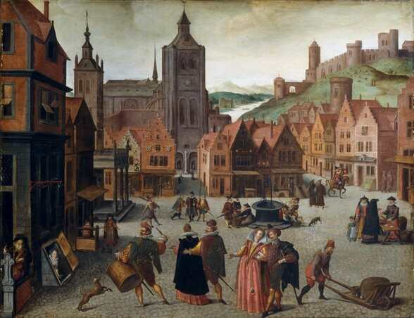 We look slightly down onto a scene showing people gathering in small groups in a cobblestone town square lined with rows of brick, wood, and stone buildings, many with stepped rooflines, to our left, right, and across from us in this horizontal painting. Singly or in pairs or trios, men, women, and children walk across the square, move goods around, or talk to merchants. All the people have light skin and are dressed elegantly. Many of the men have mustaches and wear hats, and some carry swords. In tones of black, olive green, brick red, and plum purple, they wear hip-length cloaks over jackets, with white collars or ruffs and brass buttons, and knee-length breeches over yellow or black stockings. The women all wear long dresses in salmon pink, coral red, or golden yellow, with white collars or ruffs, and many wear black, ankle-length cloaks, some with hoods. Closest to us, a sumptuously dressed man and woman walk toward us while another similarly elegant couple walks away. Also facing away from us, to our left, a drummer wearing a large drum strapped around his waist raises one drumstick as he looks over his left shoulder. Nearby, a woman peers up out of a cellar door that opens on an angle to the street. More couples gather around a well across the square and two women and a child talk to a third woman selling wares at a wooden table to our right. A pair of hooded priests or monks walk near a man blowing on a trumpet on horseback. The buildings are mostly shades of brick red and brown, and most have three or four stories with steeply pitched roofs. More people walk along side streets leading off the main square. One gap in the buildings across from us leads to a nickel-gray stone church with a pointed spire and square tower. A grassy, green hill rises steeply beyond the buildings to our right, leading down to a waterway that extends up and away into the distance. A few tan-colored boats float in the water, which reflects the leaden gray sky as a white strip along 