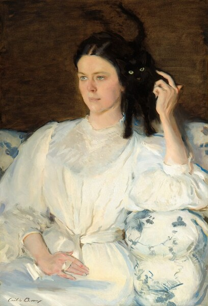 """A woman with pale skin and dressed in white sits on a couch gazing into the distance to our left as she raises one arm to stroke a black cat perched on her shoulder in this vertical portrait. Seen from the lap up, the woman's dress has voluminous puffed elbow-length sleeves and a high collar, and her narrow waist is cinched with a white sash. Her dark brown hair is parted down the middle and tied back, and she has pale blue eyes and pink lips. She reaches up to the cat with her left hand, on our right, and her other hand, farther away from us, rests flat in her lap. The black cat looks at us with greenish-yellow eyes as it almost disappears into the dark brown background above the white couch, which is decorated with a blue pattern. The artist signed the work with dark letters in the lower left corner: """"Cecilia Beaux."""""""