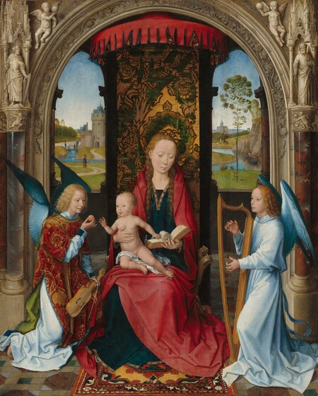Shown under an ornately carved stone arch, a young woman holds a baby on her lap as she sits on a curving gold chair flanked by two kneeling angels in this vertical painting. All of the people have pale skin. The woman has long blond hair, a straight nose, and a small pink mouth. Her body faces us but she gazes down. She wears a gold-trimmed deep blue robe under a crimson mantle that covers her shoulders and drapes over her lap and to the floor. She holds an open book with her left hand, on our right, and supports the sitting baby's body with her opposite hand. The baby is nude except for a piece of white fabric across one thigh. The baby touches the open book with one hand and reaches towards a small, round piece of fruit the angel on our left offers. The angel has blond hair and blue wings, and wears a pale blue garment under an apple red and gold patterned robe. The angel holds an instrument like a violin and bow in the left hand. The angel to our right has similar hair and facial features, and has blue wings and a sky blue robe. Both hands strum a harp as the angel gazes to our left almost in profile. Behind the chair, a cloth patterned in rich green and gold hangs vertically from a curving red overhang between tall, narrow archways that open onto a distant landscape. People move through green fields and along a river winding towards a castle to our left beneath a watery blue sky. The stone archway that frames the scene and seems close to us is painted to look as if it were carved along the arch with a vines, lizards, and snails. A bearded man stands to either side near the curving top and winged, nude, child-like people, putti, hold orbs aloft in the upper corners.