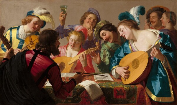 This horizontal painting shows a group of eight light skinned musicians and onlookers gathered closely around a rectangular, carpet-covered table. The front edge of the table runs parallel to the bottom edge of the painting, and seems close to us. Shown from about the waist up, the men and women's vivid blue, red, yellow, and green garments fall in crisp folds. Bright reflections on the fabric suggest a satin-like material. Two women wear feathers in their hair and one man's hat is plumed. One man, wearing crimson and black, sits with his back towards us to our left on the near side of the table. He holds the neck of a bass viol, about the size of a cello, with his left hand and points to pages of an open music book with the bow in his right hand. The other figures cluster on the opposite side of the table. A man to the left plays a violin; a woman at the center plays a guitar-sized bandora and a woman to our right plays a lute. The musicians, along with a man who leans over the table from between the two women, look down at the music books. A young man behind the woman at the center holds up a glass of pale liquid with his right hand as he touches his left forefinger to his smiling lips. A man and woman stand close together in the background to our right, in the top right corner of the canvas.