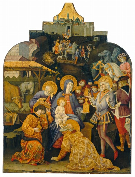 Dozens of people form a line starting from an opening to a city wall or building in the background to a rustic shed-like manger close to us to pay homage to a seated woman holding a baby on her lap in this vertical painting. All of the people have pale white skin. The top edge of the panel is shaped so it has two rounded sections like shoulders leading to a stepped, crown-like form with an inward curving triangle at the top. A nickel gray, crenelated stone wall of a distant city is nestled into the top, stepped section, with a glimmering gold sky above filling the uppermost triangle. Tile-roofed and domed buildings and a few towers appear densely packed beyond the wall. People on foot and horseback create a line from an arched opening in the wall towards us and to our right. Three of the people on horseback in the distance wear long robes and have gold halos. The line of people winds behind a tall, narrow hill to our right and it continues close to us. Two horses, two camels, and several people wait to the right but our attention is drawn to the trio in the foreground, Mary, Jesus, and Joseph, and the three men waiting on the infant, the Three Magi. Mary wears a lapis blue mantle covering her head and shoulders over a petal pink dress and she sits on a wooden or stone chest in the center of the painting. Her body faces us but she turns her face to look with pale blue eyes towards the hexagonal gold vessel that tapers to a flame-like finial she holds in her left hand, on our right. The blond infant sitting in her lap is covered only with a white cloth around his waist, and he looks towards the vessel as well while holding up the index and middle fingers of his right hand. To our left and slightly behind Mary, a balding man with white hair and beard and wearing a blue garment under a red robe sits with his head propped in his hand, looking down. His opposite hand rests on what might be the handle of a crutch or staff. The man, woman, and child have gold halos with wha