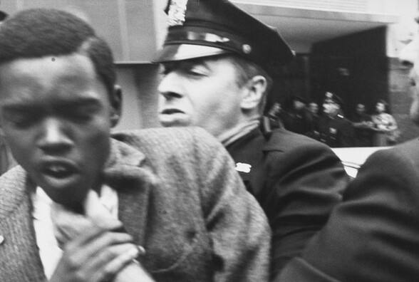 Black man being forced aside by police, New York City