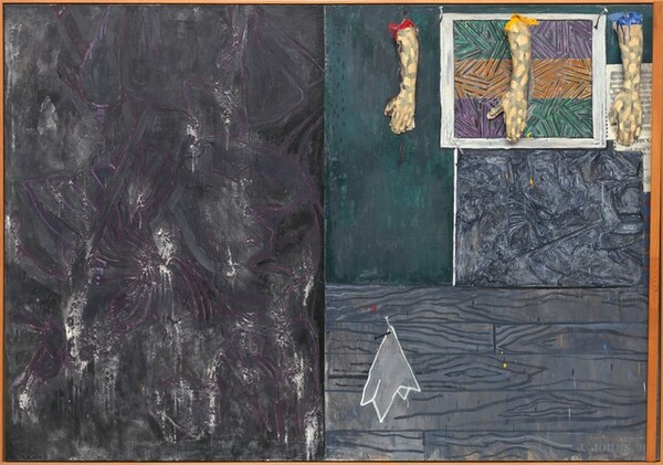 "Three casts of human hands and forearms hang from the top edge of the right half of this horizontal abstract painting, which is divided vertically in two equal parts. The rectangular field to the left is mottled with steel and charcoal gray streaked with white and amethyst purple. The panel to the right is divided again so the top half is slightly larger than the bottom half. The bottom portion is painted with a pattern to resemble abstracted wood grain in nickel and slate gray. A stylized white cloth, perhaps a handkerchief, is painted to look as if hanging from a nail hammered into the wood paneling, to our left. The top portion seems to be layered with paintings and prints below and beneath the three arms. The arms hang from looped metal wires on metal hooks spaced along the top edge, coming about a quarter of the way down the overall composition. The peach colored arms and hands are painted all over with irregular gray patches, creating a camouflage effect. They hang down so the open palms are flat against the canvas, the thumbs extended to our left. The top of the arm to our left is painted cherry red, the middle is painted canary yellow, and the right arm royal blue. The paint drips down the arms and splatters on the hands and on the faux wood panel below. Behind the hands, it appears that one of the artist's prints hangs from two nails on the canvas. The illusionistic print has three horizontal bands of pine green, pumpkin orange, and violet purple crisscrossed with black lines. Seeming to hang behind it and under the right-most arm is a sheet of music overlapping another piece of paper printed with the letters ""OHN C"" and ""THE PERILOUS."" Below, and filling the space between the illusionistic print and the wood panel, is a rectangular field of abstract gray and black swirling forms. The entire canvas is surrounded by a thin, amber-colored wood frame. A narrow wooden slat is hinged on the inner surface of the frame at the bottom right corner, and runs up along the canvas near the rightmost edge of the frame. The artist signed the work with stenciled letters in pale gray in the lower right corner: ""J. JOHNS '8."""