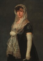 """Shown from the knees up against a dark gray background, a young woman with pale skin stands with her body angled to our left and she looks directly at us with brown eyes in this vertical portrait painting. She has dark, arched brows, a straight nose, and her full, coral-pink lips are closed. Her dark brown, curly hair is covered by a mantilla, an ivory-white, lacy scarf highlighted with pale gold and subtle, russet red highlights that she holds with her right hand, farther from us, below her bust. The ends of the scarf fall to mid-thigh over her ink-black, long dress. The bust of her dress is made from the same or similar shimmering material of the mantilla. Long, tight-fitting, off-white gloves nearly reach the short, puffed, cap sleeves of the dress. The back of the glove on her left arm, closer to her, is tied at the top with a bow, and she holds a silvery-white, closed fan in that hand. A brownish-coral colored necklace is painted as a squiggle of paint around her neck. Barely visible, the painter signed the painting in the lower left: """"Goya."""""""
