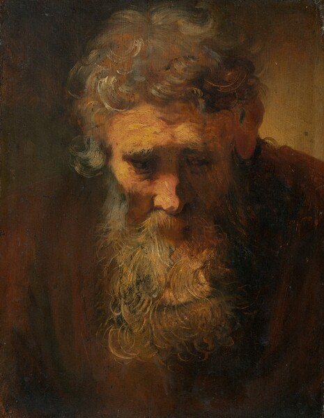 A man with thick, tousled grey hair and a long beard squared off at the bottom bows his head toward us in this vertical portrait painting. His head and chest fill the canvas, except for a black area of undefined space above his right shoulder and a pale yellowish grey area on the upper right that implies light glowing faintly behind his left shoulder. Against the surrounding darkness, light picks out the pink flesh of his forehead, right cheek and nose, overlain with loose patches of yellow. His heavy grey brows, drawing together, cast shadows over his baggy eyes. The dark irises moving toward our right are just visible, barely contrasting with the dull brown whites. The artist seems to have used a palette knife or brush end to incise rippling wrinkles through the yellowish paint on his forehead. Loose brushstrokes sketch short, grey curls, a few of them streaked with white, covering the top of his head. One grey lock falling down his right temple curls up and outward into space. On the other side, his reddish-brown left ear is in shadow. Linear grey and tan strokes define individual curling strands of his beard and moustache. A light reddish-brown triangle pointing downward, below the moustache, hints at a mouth. His beard ends in row of curls and projecting tufts a little way above the lower edge of the canvas. The vertical folds of a chestnut-brown garment hang down from his shoulders.