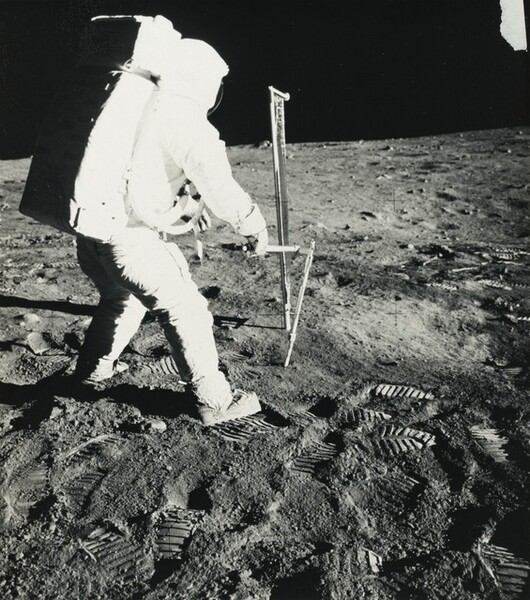 Apollo 11 Lunar Module Pilot Edwin E. Aldrin, Jr. Uses Core Sampler to Remove Lunar Soil Samples...