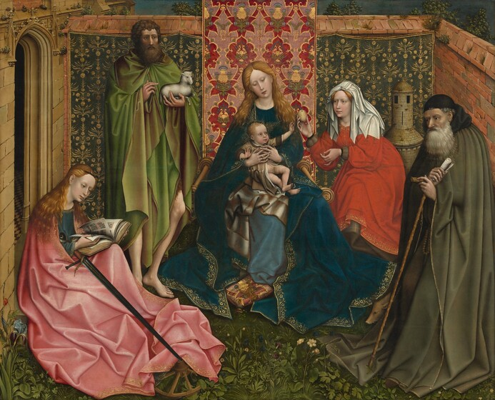 Three women, two men, and one infant are gathered within a walled garden that extends off a building, its façade visible to the left, in this horizontal painting. The women have pale white skin and the men have olive-toned complexions. The men and women all wear voluminous, flowing robes and garments in lapis blue, ruby red, rose pink, olive or spring green. At the center a woman supports a partially nude and squirming infant on her lap. The woman has wavy golden blonde hair and wears a dark blue velvet robe that pools on the ground around her, with a lighter blue dress beneath, and is seated on a chair with wooden spindle arms facing forward, toward us. She holds up the infant with interlaced fingers that wrap around his middle, and she inclines her head down and to our left toward the infant. The child has blonde hair, wide open blue eyes, and a chubby, pink-cheeked face. He is wrapped in a long, shimmery gold robe with brown cuffs and collar, which is open over his lower torso and legs. Facing our right, the child reaches with his left arm, palm outward. An array of shimmery, gold painted lines fan outward all around the heads of the woman and infant. Just beyond the child's reach, a woman in a red dress and shoulder-length white head covering bends toward him and holds out a golden apple or other fruit. To our right, an elderly man has a full grey beard and he gazes towards the woman and child. He leans, semi-stooping, on a walking stick that pierces the hem of his garment. He wears a flowing cape in olive green and a black skullcap that has a kerchief off the back. At his right foot, a small hog noses out from amid the draped garments. To the left of the woman and child pair stands a tall man in a spring green cape with a gold lining, which hangs around his knees, exposing his lower legs and bare feet. He has bushy brown hair and a full beard and cradles a small white lamb in his left arm, while gesturing toward it with his right. His head is turned toward our 