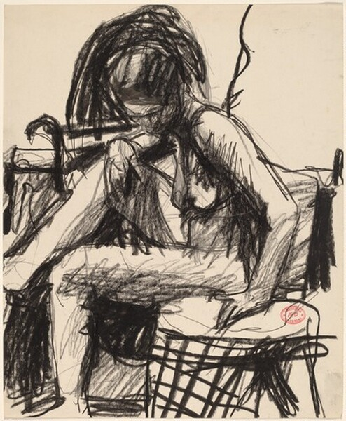 Untitled [seated nude placing her hand on a side table]