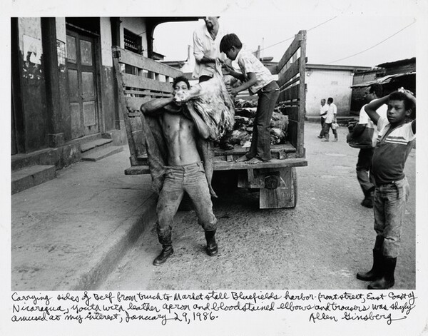 Carrying sides of Beef from truck to Market stall Bluefields harbor-front street, East Coast of Nicaragua, Youth with leather apron and bloodstained elbows and trousers was shyly amused at my interest, January 29, 1986.