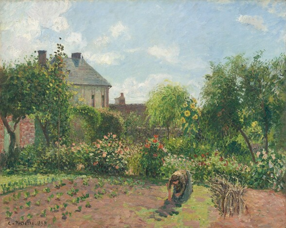 """A woman bends over, tending a garden that stretches before us in front of two houses in this horizontal landscape painting. The scene is painted with short, visible brushstrokes with a palette dominated by spring, pine, and celery greens and earthy tan, peanut, and chestnut browns. Touches of canary yellow, pale pink, coral, and ruby red suggest sunflowers, roses, and other flowers. The woman wears a long steel-gray skirt and a long-sleeved army-green shirt. Her brown hair is bound up and her face and hands, indicated with only a few short swipes of paint, are pale peach. She stoops over a light green patch to our right of center near a bundle of sticks or a group of tall dried stems, to our right. Leafy greens have been planted in rows to our left. Across from us, beyond the cultivated rows, masses of flowers grow in a band that nearly spans the width of the composition. Beyond, a gray stone house with a dark gray roof and a second brick red roof rise above the plants and trees. The pale blue sky above is dotted with cotton white clouds. The artist signed and dated the work with dark paint in the lower left corner: """"C. Pissarro 1989."""""""