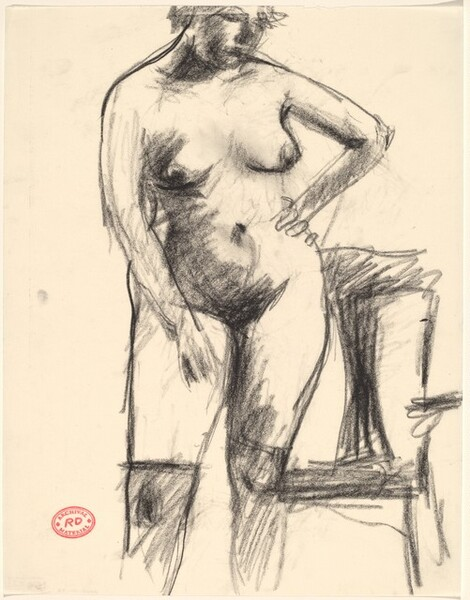 Untitled [nude in black stockings standing before an armchair]