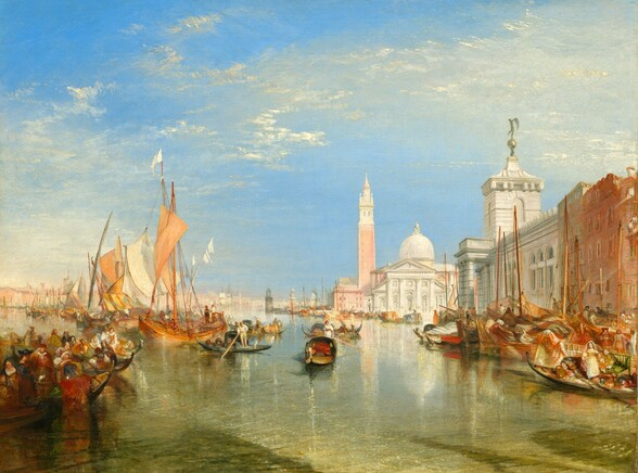 We seem to stand on or over the water looking across a glittering canal lined with long, low boats and sailboats at an ivory colored church in the distance to our right in this horizontal landscape painting. The horizon line comes about a third of the way up the composition and wispy white clouds sweep across the brilliant azure blue sky above. A row of buildings comes into view lining the canal to our right, with a terracotta colored building followed by a creamy white building beyond, both angled towards the church. The church has a high dome rising beyond the temple-like front with columns and a triangular pediment. A tall bell tower rises to the left of the church. The low boats, gondolas, to our left are packed with people while a few gondolas floating in the center of the canal appear occupied only by their gondoliers standing and holding their poles. Painted in tones of ivory and apricot, the sails of boats behind the gondolas to our left billow in the breeze while the sails of vessels docked to our right are furled. The structures, boats, and people cast shimmering reflections on the glass-like water of the canal. Rows of boats and buildings lining the canal extend seemingly indefinitely into the deep distance to our left.