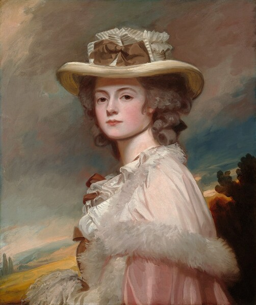 Shown from the waist up in front of a loosely painted landscape, a young woman with porcelain-white skin, flushed cheeks, and light brown hair curling softly around her face and neck turns her head to look directly at us from over her shoulder in this vertical portrait painting. Her body faces our left in profile, and she looks at us with dark brown eyes under arched brows. She has smooth, round cheeks and her pale rose-pink lips are closed. She wears a wide brimmed ivory-colored, straw hat that casts a shadow across her forehead. At the front of the crown, a tawny-brown bow is set against a ribbon striped with dove-gray and ivory. A sheer, pearl-white, gossamer cape edged with feathers or fur drapes over the shoulders of her pale, rose-pink, satin dress. Ruffles along her chest appear to be tied with fawn-brown bows. Her hands seem to be clasped in front of her waist, perhaps in a muff, but are cut off by the bottom edge of the canvas. Behind her, a harvest-gold hillside rises to a band of pine-green trees along the right edge of the composition. Filling most of the background, the opalescent sky has pewter-gray clouds angling across a sapphire blue sky.