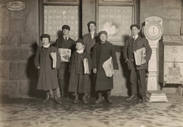 8:30 P.M. Group of newsboys selling at the depot, Hartford, Connecticut. Smallest boy 11 years old.