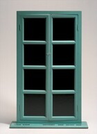 """This free-standing sculpture is a French window with a teal-colored frame and black, leather-lined glass panes standing on a flat, shallow base. Each of the two doors is made up of four, equally sized panes in vertical rows. The doors are hinged on a narrow frame and open with small, clear placed next to the second pane down from the top. The doors are slightly ajar. Black writing in capital block letters on the top surface of the base is legible in this photograph. It reads, """"FRESH WIDOW COPYRIGHT ROSE SELAVY 1920."""""""