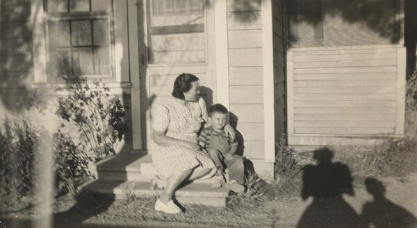 Untitled (Mother and son on porch)