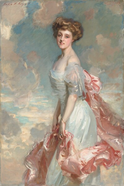 """A young woman with pale, porcelain skin, wearing a delicate, long, silvery blue or white dress with a voluminous rose-pink train looks out at us in this vertical portrait painting. She stands in front of a watery blue sky dotted with puffy white clouds shaded with shell pink and light lilac. Her body faces our left in profile and she turns her smiling, oval-shaped face to us. She leans her torso slightly forward, as if about to take a step. Her light brown hair is loosely piled on her head. Her gray-blue eyes are framed by delicate brows, and she has an aquiline nose, rosy cheeks and lips, and a long, elegant neck. Light glints off the dress she wears, suggesting is silk or satin. It has a low, straight neckline and the short, fluttery sleeve we can see falls off her shoulder. A long, billowing swath of light pink fabric is attached to the back of her dress, possibly with a large bow, and it drapes in lively folds down and around the front of her skirt. She holds it lightly with both hands at her thighs. She wears a thin gold bracelet on her left wrist, closer to us, and a silver ring on the third finger of that same hand. The portrait is loosely painted, especially in the clothing, so the texture of the brushstrokes is visible in many areas. The artist signed the work with brick red paint in the upper left, """"John S. Sargent"""" and dated it in the upper right, """"1907."""""""