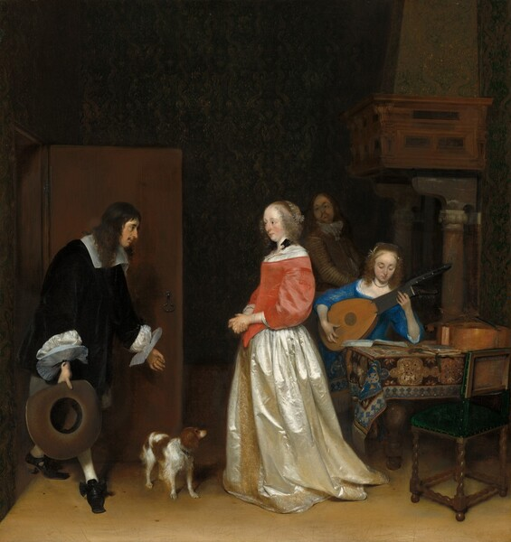 Two men and two women, all with pale skin, and a white and brown dog occupy a room in this vertical painting. One man and woman seem close to us and the other two are slightly behind them to our right. From left to right, a man with long dark hair and a mustache enters the room through an open door. He wears a voluminous, velvety black jacket that has a wide white collar and flat, plate-like starched white cuffs. He leans forward in a bow, one foot stretched in front of him and gazing towards the woman to our right. His hands are spread wide. His left forefinger and thumb making an O and he holds a wide-brimmed hat in his right hand, closer to us, so we see into the crown. At the center of the composition, the woman wears a dress with a coral pink bodice and a cream-colored satin skirt that has a gold band down the front and around the hem. She faces and looks towards the man, her cheeks flushed. Her eyebrows seem slightly raised over dark eyes, and she has a straight nose and the hint of a double chin. Her blond hair is pulled back under what could be a lace covering, and curls frame her face. A black ribbon is tied into a bow at her neck. The tawny brown and white dog stands about knee-height, between the man and woman. To our right, a young woman with similar features sits opposite us at a table playing a lute. She wears a royal blue dress and looks down at her instrument. One elbow is propped on the patterned rug that covers the table. An instrument, perhaps a cello, lies on the table and a wooden chair with a green upholstered seat has been pulled up to our side of the table. Almost lost in the shadows at the back of the room between the two women, a man with a goatee and wearing a brown jacket and trousers stands with his body angled to our right as he looks over his shoulder towards the couple at the door. He stands in front of a fireplace with an opening so large that the mantle supported by columns tall columns is above his head.