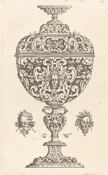 Goblet decorated with a masque with open mouth