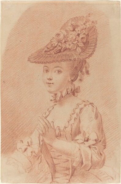 A Young Girl Wearing a Flowered Hat