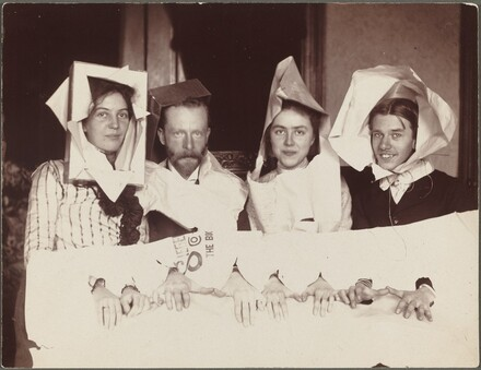 Untitled (Four men and women in paper costumes)