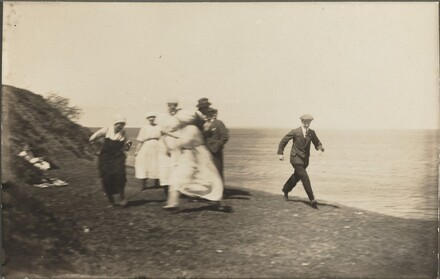 Untitled (Blurred group in motion on beach)