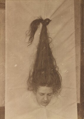 Untitled (Woman with head through sheet)