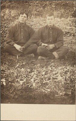 Untitled (Seated men holding hands)