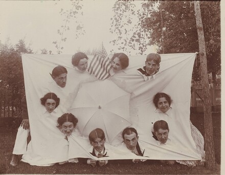 Untitled (Group sticking heads through a sheet)