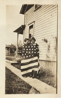 Untitled (Two women wrapped in American flag)