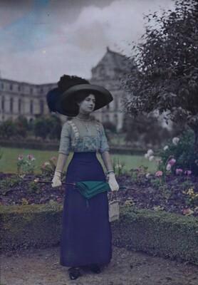 Woman with Umbrella in Garden
