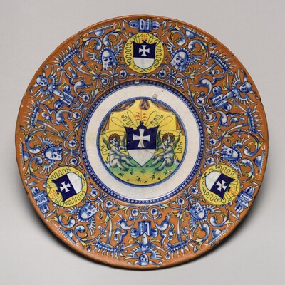 Plate with border of grotesques on an orange ground and three shields of the arms of the Gritti of Venice; in the center, putti holding another shield of the same arms
