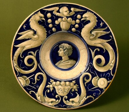 Broad-rimmed bowl with border of dolphins and delphigriffs; in the center, head of a young man