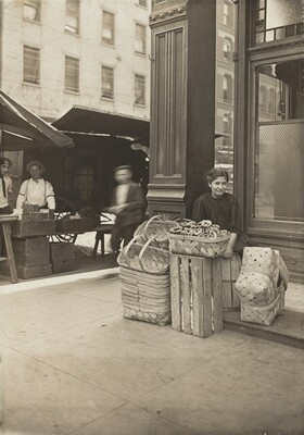 Lena Lochiavo - 11 years old, basket (and pretzel) seller, at Sixth Street Market in front of saloon entrance, Cincinnati, Ohio