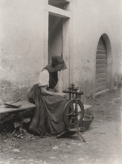 Old Woman with Spinning Wheel