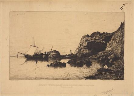 Barque de pecheurs faisant escale dans les rochers de Collioure