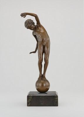 Boy Balancing on a Ball