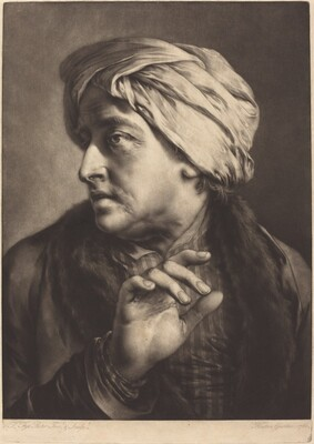 A Man with a Turban and Striped Shirt