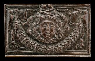 End panel of a writing casket: Medusa Head, Garland, and Bucrania